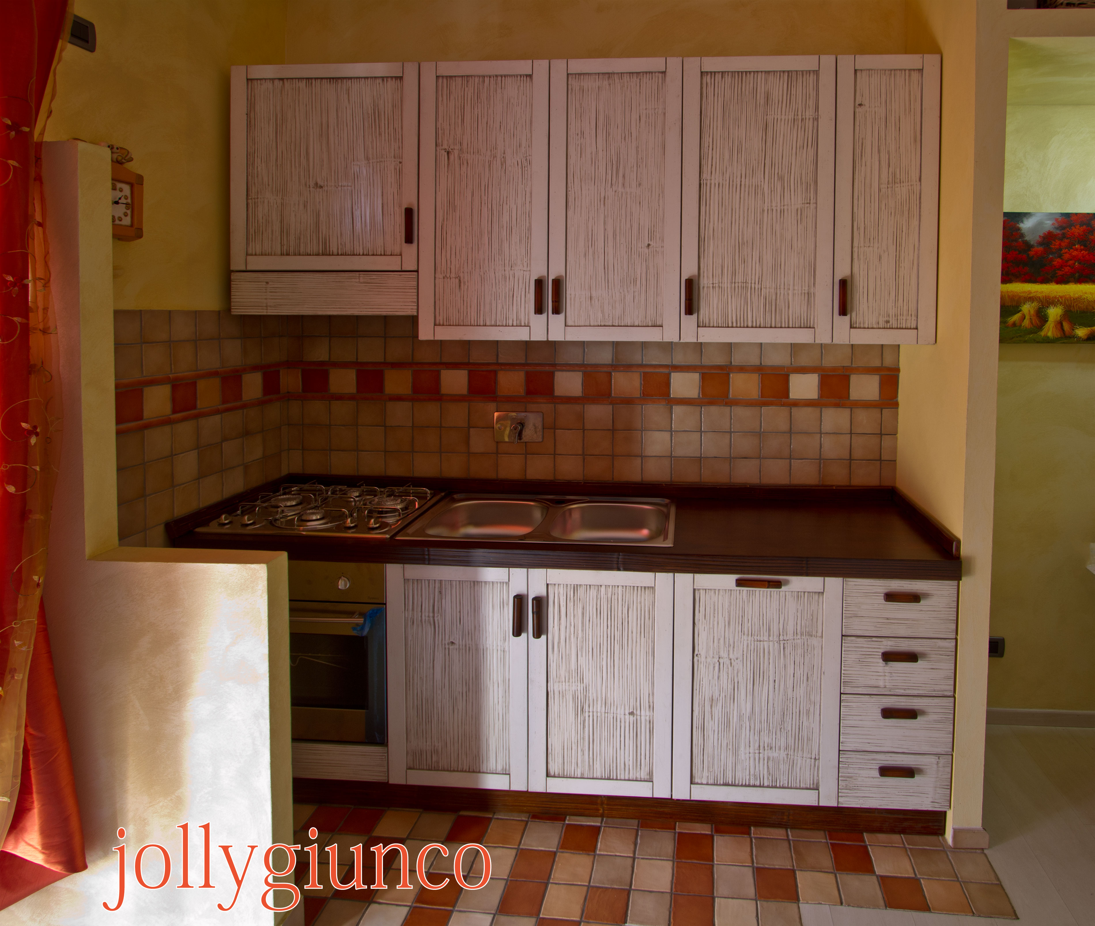 Arredamento etnico cucina: legno, teak